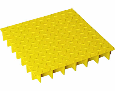 A piece of yellow molded FRP grating with diamond shape covered surface on black floor.
