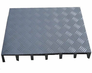 A piece of grey molded FRP grating with five-bar shape covered surface.