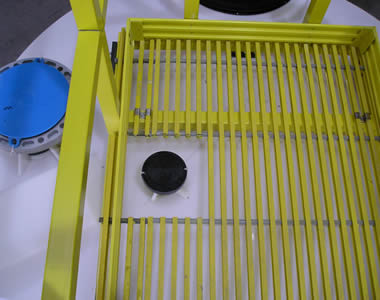 Yellow pultruded FRP gratings as the top platform of a tank.