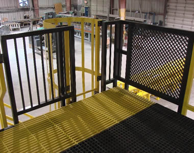 A corner of a FRP operating platform, using both yellow pultruded and black molded FRP gratings as the floor.