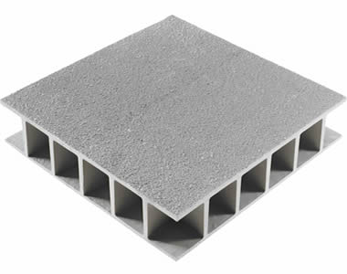 A piece of grey molded FRP grating with gritted top covered surface and bottom.