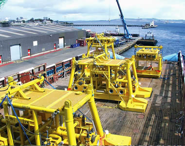 Two offshore oil platforms made of yellow FRP gratings standing on the deck.