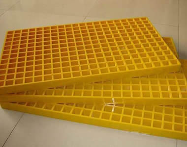 There are three yellow molded FFP gratings with square holes on the floor.