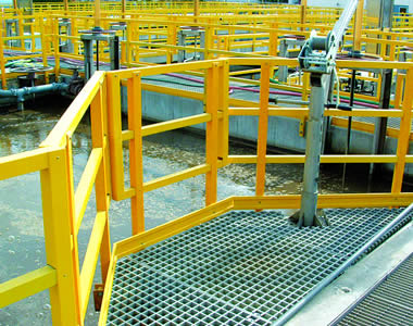 A piece of trapezoid white FRP gratings is over the waste water and surrounded by yellow FRP fences.