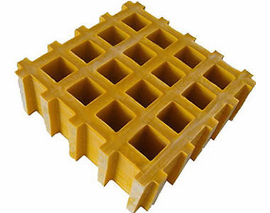A piece of yellow FRP grating with square holes and concave surface.