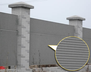 Several pieces of thick FRP gratings made up a fence wall with brick pillars